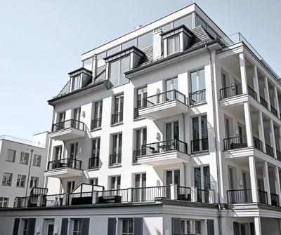 Nowoczesna nieruchomość, przywołująca refleksje na temat jakim jest kredyt deweloperski warunki