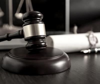 Symbol sądownictwa, stanowiący o zapisie prawnym, jakim jest rękojmia wiary ksiąg wieczystych